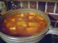 photo of orange squash soup in a cazeula